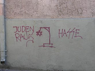 "Discrimination - Antisemitic graffiti in Lithuania. The signs read ""Jews out"" and ""Hate"""