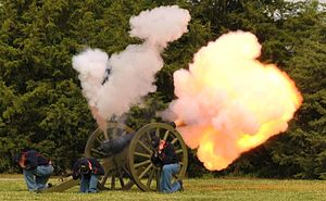 "Fort Riley - 7th Field Artillerymen fire ""Old Glory"", a replica of a Civil War field piece, at a 2012 ceremony at Ft. Riley."