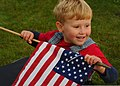 A 5-year-old boy watches U.S. special tactics Airmen pass by him during the Tim Davis Memorial March in Madisonville, La., Oct. 23, 2011 111023-F-PV498-029.jpg