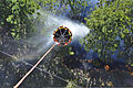 A U.S. Army UH-60 Black Hawk helicopter assigned to the Colorado Army National Guard performs a water drop while fighting the Black Forest Fire near Colorado Springs, Colo., June 12, 2013 130612-Z-UA373-476.jpg