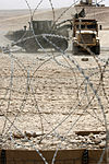 A U.S. Marine Corps tractor dumps sand into a medium tactical vehicle replacement at Camp Bastion, Helmand province, Afghanistan, Aug. 7, 2013 130807-M-SA716-104.jpg