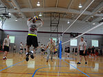 A U.S. Soldier assigned to the 4th Brigade Combat Team, 82nd Airborne Division, sets up a volleyball for one of his teammates during All American Week's volleyball competition, at Fort Bragg, N.C., May 20 130520-A-AB123-302.jpg