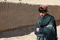 A boy walks down a street in Nyalak Kalay village, Zabul province, Afghanistan, Dec. 7, 2011 111207-A-QD683-102.jpg