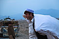 A local Afghan man watches his vehicle being searched by members of the Afghan Uniformed Police at a checkpoint, in the Nazyan district, Nangarhar province, Afghanistan, March 10, 2012 120310-A-LP603-191.jpg