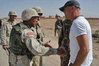 Albert Bryant Jr. - Bryant in September 2003, speaking with Bruce Willis in Tikrit, Iraq.