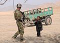 Afghan and coalition forces patrol western Kandahar village DVIDS545424.jpg