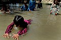 Afghan children swim in a lake in Arghandab, Zabul province, Afghanistan, July 25, 2011 110725-F-FT240-181.jpg