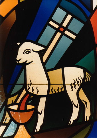 Lamb bleeding into the Holy Chalice, carrying the vexillum Agnus Dei with Vexillum.jpg