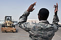 Air Transportation Airmen From the 380th Expeditionary Logistics Readiness Squadron's Air Terminal Operations Center Drives a 60,000-pound-capable Aircraft Loader to Unload a Plane During Operations DVIDS290902.jpg