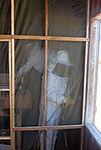Airman moves bee colony on GITMO DVIDS213633.jpg