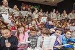 Airmen, school children serenade residents 141209-Z-AL508-010.jpg