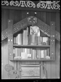 Albert Percy Godber's bookcase with a Maori carving surround ATLIB 127427.png