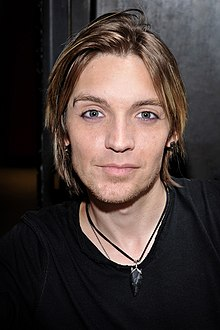 Alex Band earned a  million dollar salary, leaving the net worth at 0.5 million in 2017
