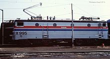 Silver locomotive with red and blue stripes