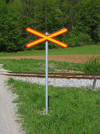Level crossing - Most crossings in Europe and around the world are marked by some form of saltire (Saint Andrews Cross) to warn road users about a level crossing and/or about a level crossing with no barriers whatsoever. This cross is on a level crossing in Slovenia.