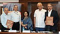 """Ashok Gajapathi Raju Pusapati witnessing the signing ceremony of the MoU for joint development and launch of the Post Graduate Diploma in """"AviationAirport Operations"""" between GMR Aviation Academy and Rajiv Gandhi National.jpg"""