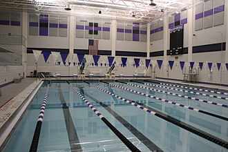 Baldwin High School (Pennsylvania) - BHS Natatorium, featuring a 6-lane pool with a 12ft diving well, dual diving boards, timing system, and upper viewing deck.