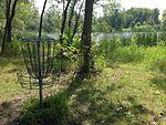 Basket near lake at Lochness Park disc golf course.JPG
