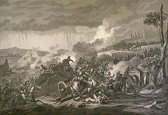 Dark clouds hang over a battle field. Trees have their tops blown off. Bodies of men and horses are scattered. A cannon lays overturned in the foreground.