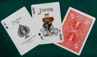 Bicycle Playing Cards - Current Bicycle playing cards: Ace of spades, joker, and the back of a card in red