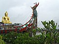Big Buddha with Dragon Boat Sculpture - Sop Ruak - Golden Triangle - Thailand (35192642801).jpg