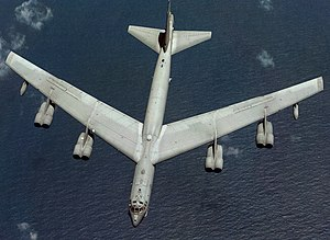 Aerial top/side view of gray B-52H