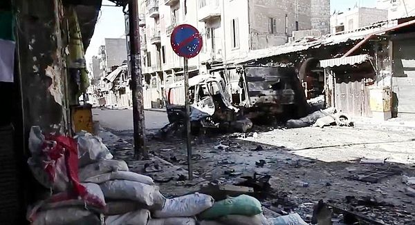 Destroyed vehicle on a devastated Aleppo street, 6 October 2012 Bombed out vehicles Aleppo.jpg