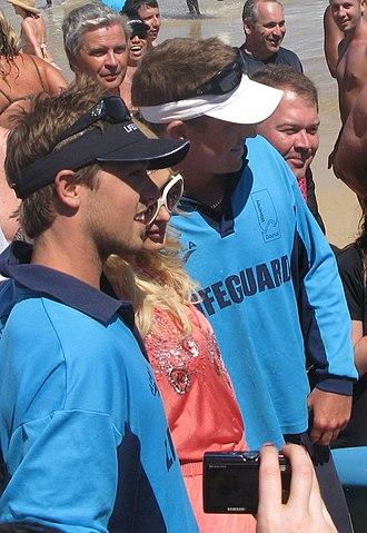 "Bondi Rescue - Dunstan ""Dunno"" Foss (black cap) and Ryan ""Whippet"" Clark (white cap) with Paris Hilton on Bondi Beach on New Year's Eve 2008"