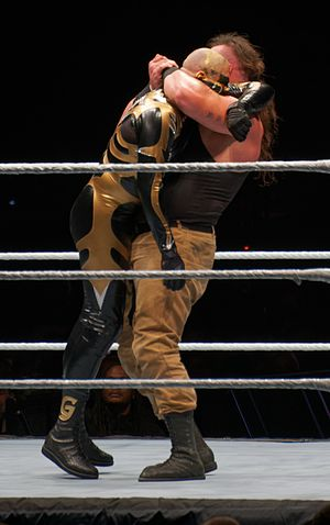 Braun Strowman - Strowman applying a Lifting arm triangle choke on Goldust