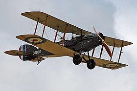 Colour photo of biplane in flight