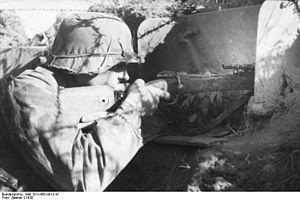 ZF41 - An SS rifleman aims through a ZF-41 scope on his Kar98k rifle