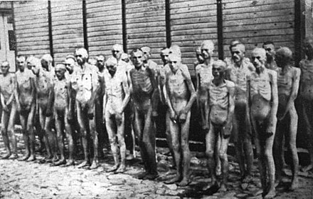 Soviet POWs standing before one of the huts in Mauthausen - Mauthausen-Gusen concentration camp