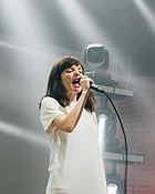 A picture of Lauren Mayberry, lead of singer of Chvrches on stage.