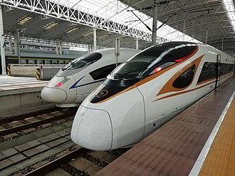 Passenger rail transport in China - CRH380B EMU and CR400BF EMU in Shanghai Railway Station