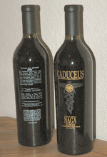 Two wine bottles, one showing the front label and the other showing the back label.