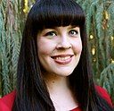 Caitlin Doughty in red evergreen background.jpg