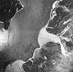 Casement Glacier, outwash plains, glacial remnents and icebergs in the water, August 24, 1963 (GLACIERS 5283).jpg