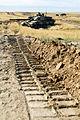Challenger 2 tank tracks in mud MOD 45149587.jpg