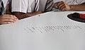Children reading the Prime Minister, Shri Narendra Modi's writing on the Agro Robot, at Queensland University of Technology, in Brisbane, Australia on November 14, 2014 (1).jpg