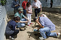 Chinese delegates collect turtle eggs (6948098426).jpg