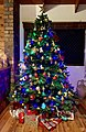 Christmas tree with presents in a privite house on Christmas Eve night.jpg
