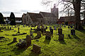 Church of the Holy Cross Felsted Essex England - churchyard at northeast.jpg