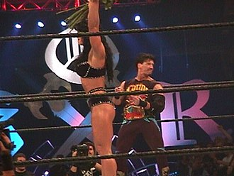Chyna - Chyna at King of the Ring along with Eddie Guerrero during their romance angle; Guerrero would often give Chyna flowers before a match