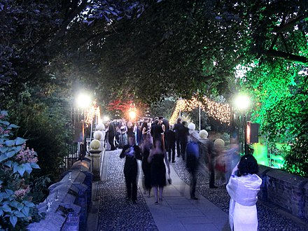 The bridge over the River Cam at Clare College during its 2005 May Ball Clare Bridge, May Ball 2005.jpg