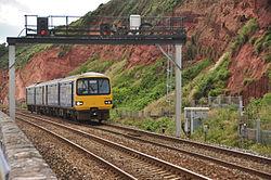 Class 143 on the sea wall near Dawlish (4898).jpg