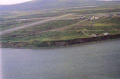 Aerial view of Cold Bay taken during the late 20th century. Cold Bay Airport's runways are visible.