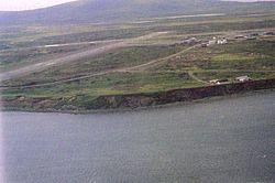 Cold Bay sometime in the late 20th century. Cold Bay Airport '​s runways are visible.