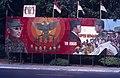 Collectie NMvWereldculturen, TM-20019407, Dia- Schildering ter gelegenheid van het 40-jarig jubileum van de viering van Onafhankelijkheidsdag, Henk van Rinsum, 08-1985.jpg