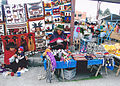 Colourful market with spinning woman Ecuador.jpg