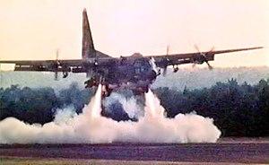 Operation Credible Sport - The C-130 prototype firing rockets to shorten its landing